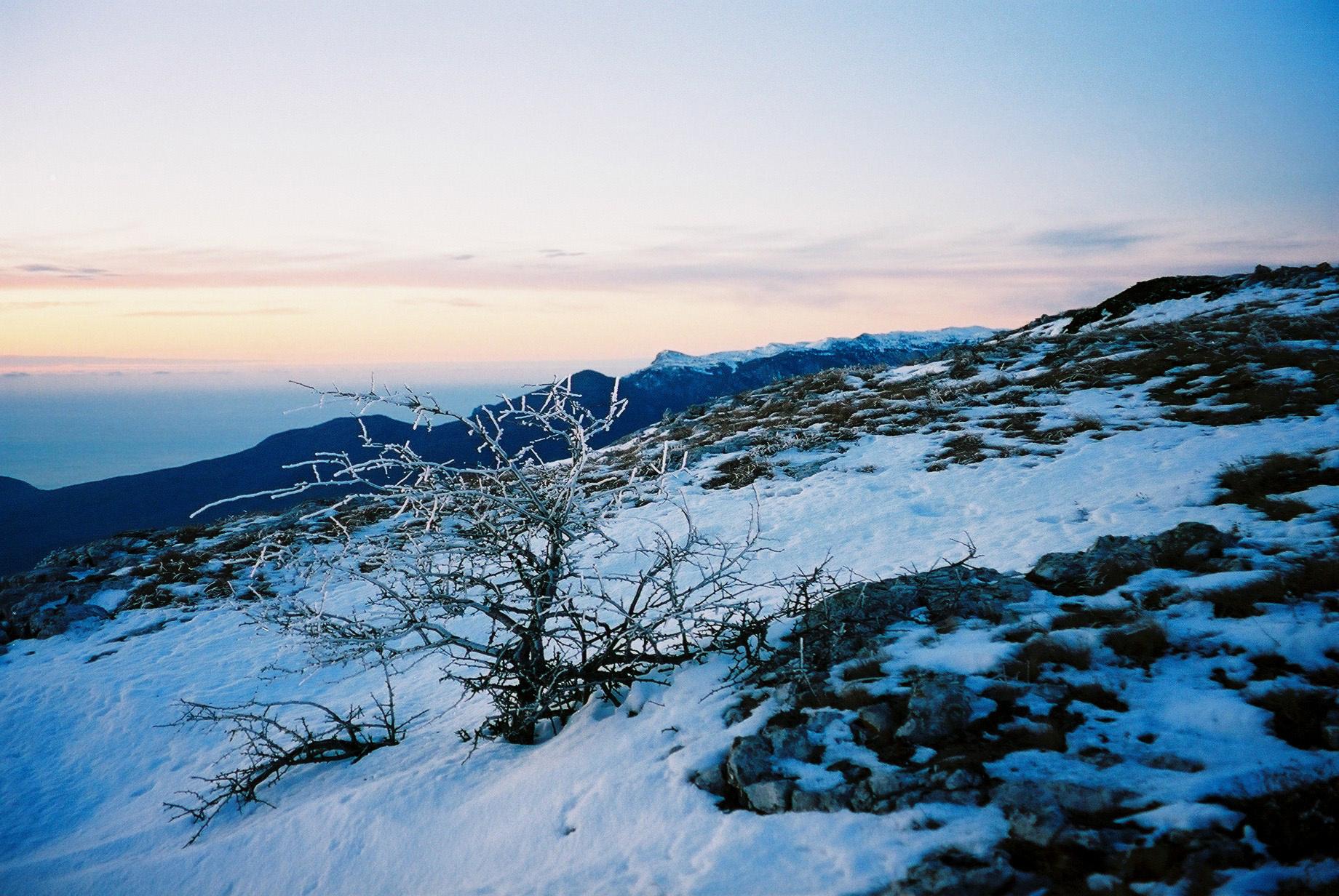 Winterlandschaft bei Sonnenuntergang